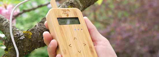 Bamboo Music of the Plants device being held in a hand while playing plant music