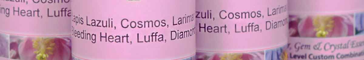 Bottles of personal flower & crystal essence combinations - close up of label with essence listing